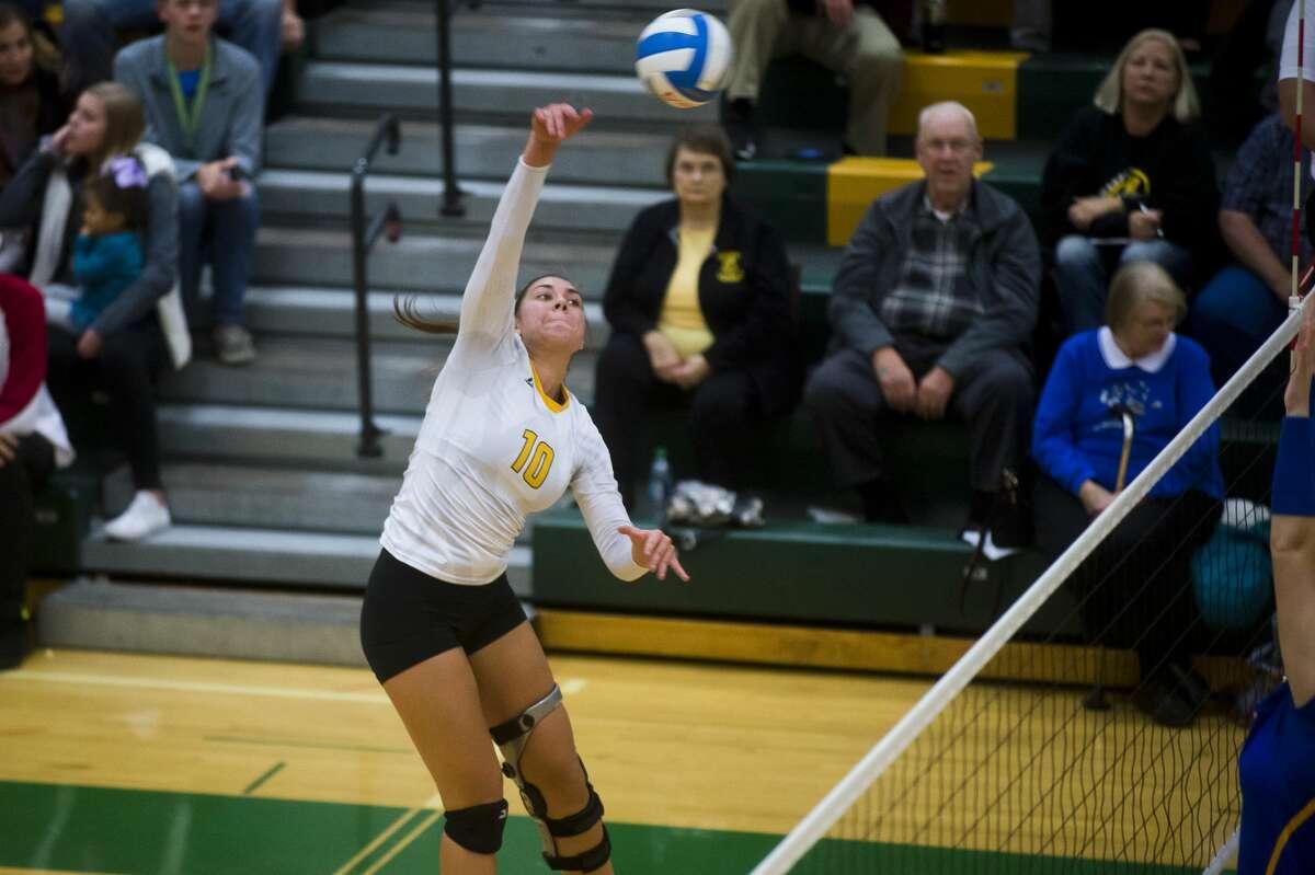 Bay City Western senior Addison Bouza spikes the ball during her team's Class A district final against Midland on Thursday, Nov. 2, 2017 at H. H. Dow High School. (Katy Kildee/kkildee@mdn.net)