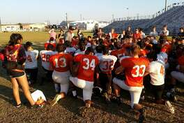 District 26-5A Medina Valley Panthers meet with coach Chris Soza after practice.