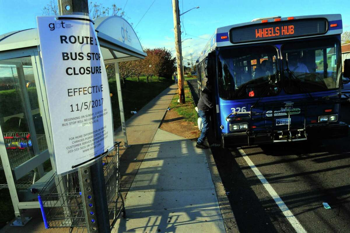 A sign notifies people of a route closure as a Greater Bridgeport Transportation bus stops at the Stratford stop near The Dock Shopping Center in Stratford, Conn., on Thursday Nov. 2, 2017. On Nov. 5, GBT will suspend 3 routes: 14, 16 & 20.
