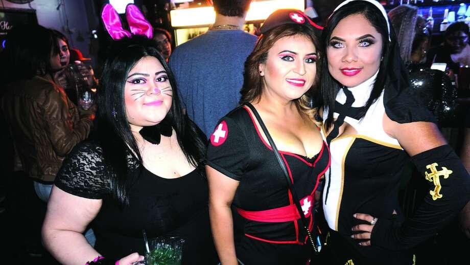 Jackie Lelloa, Sally Herrera and Selena Juarez at The Happy Hour Downtown BarFriday, November 3, 2017 Photo:  Jose Gustavo Morales