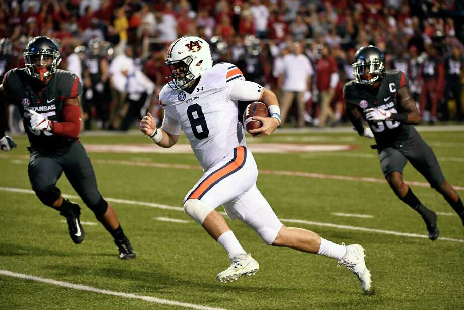 Auburn quarterback Jarrett Stidham (8) has guided the Tigers to a 6-2 record and the No. 14 spot in the latest College Football Playoff rankings. Auburn's losses to Clemson and LSU were by a combined 12 points. Photo: Michael Woods, FRE / Michael Woods Photography