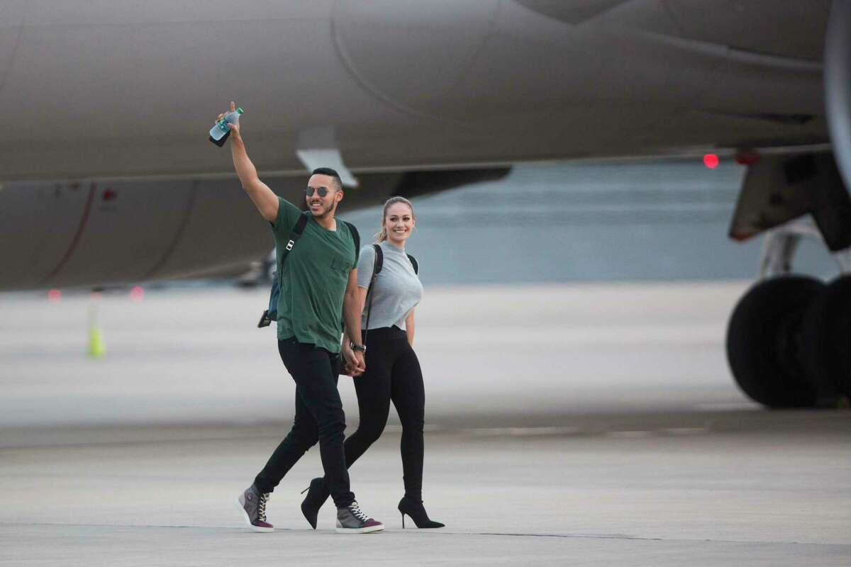 Astros' Carlos Correa arrives with his fiancé Daniella Rodriguez to Houston from California, Thursday, Nov. 2, 2017, a day after winning the World Series.