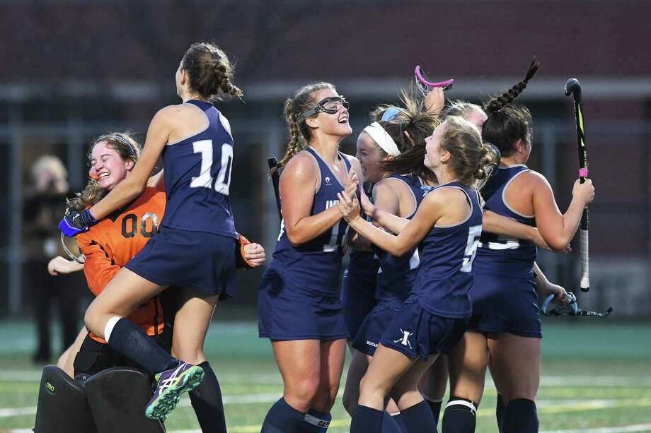 The Immaculate team celebrates their 2-1 win over Pomperaug during the SWC Field Hockey Championship game at New Milford High in New Milford, 11/2/17. Photo: Krista Benson / The News-Times Freelance