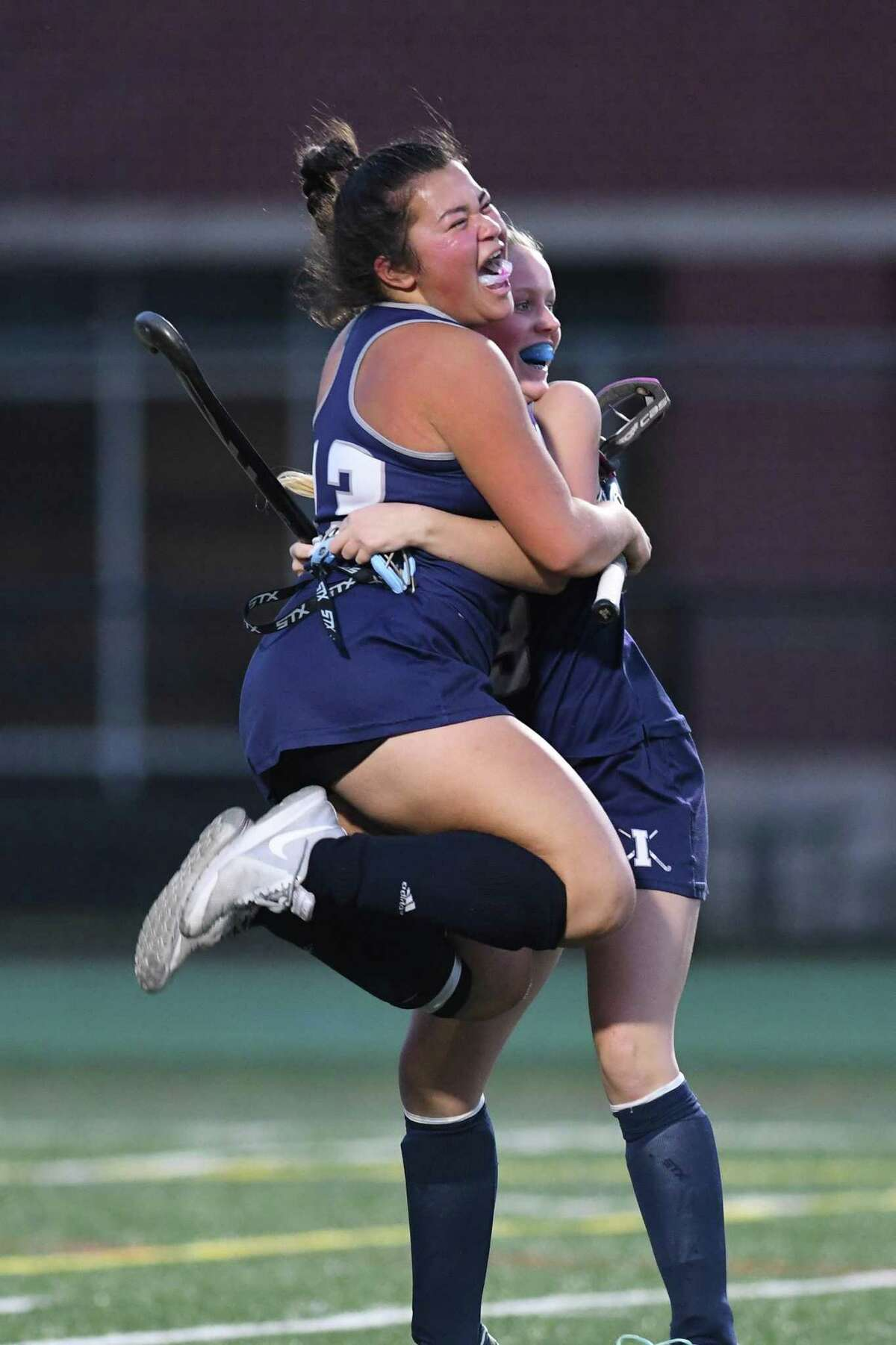 Immaculate?'s Isabella Cipollone jumps into the arms of teammate Morgan Begler after the team?'s 2-1 win over Pomperaug during the SWC Field Hockey Championship game at New Milford High in New Milford, 11/2/17.