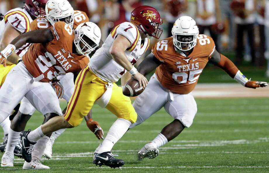 Texas defensive end Charles Omenihu (90), once a 230-pound freshman, has added nearly 45 pounds to his frame. The junior ranks second on the team in sacks. Photo: TOM REEL, STAFF / 2016 SAN ANTONIO EXPRESS-NEWS