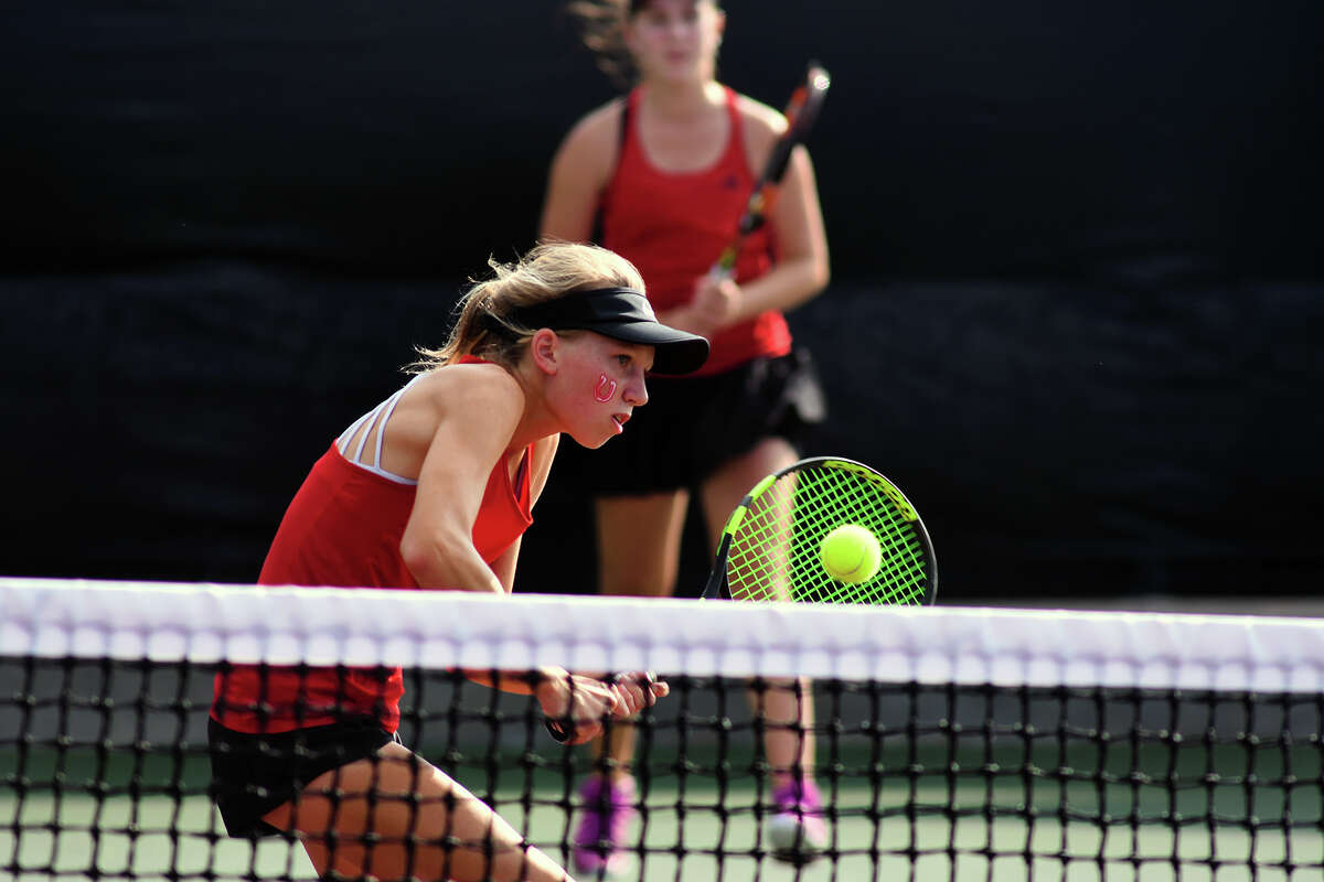 Houston Memorial's Drew Morris works her backhand at the net during her Girl's Doubles match with partner Natalija Dimitrijevic against Cypress Ranch's Melissa LaMette and Rilee Marler in their 2017 UIL State Team Tennis Final at the George P. Mitchell '40 Tennis Center on the campus of Texas A&M University on Thursday, Nov. 2, 2017. (Photo by Jerry Baker/Freelance)