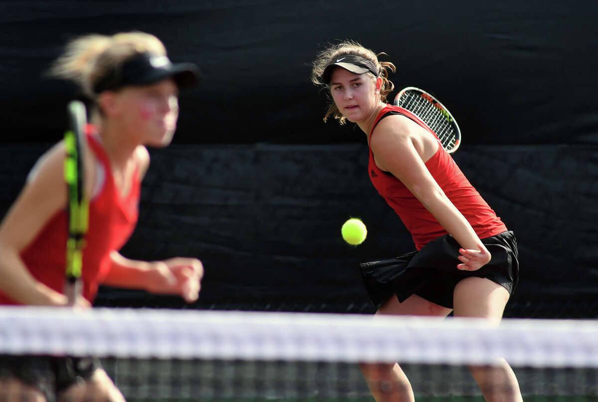 Houston Memorial's Natalija Dimitrijevic, right, works her forehand behind partner Drew Morris during their Girl's Doubles match against Cypress Ranch's Melissa LaMette and Rilee Marler in their 2017 UIL State Team Tennis Final at the George P. Mitchell '40 Tennis Center on the campus of Texas A&M University on Thursday, Nov. 2, 2017. (Photo by Jerry Baker/Freelance)