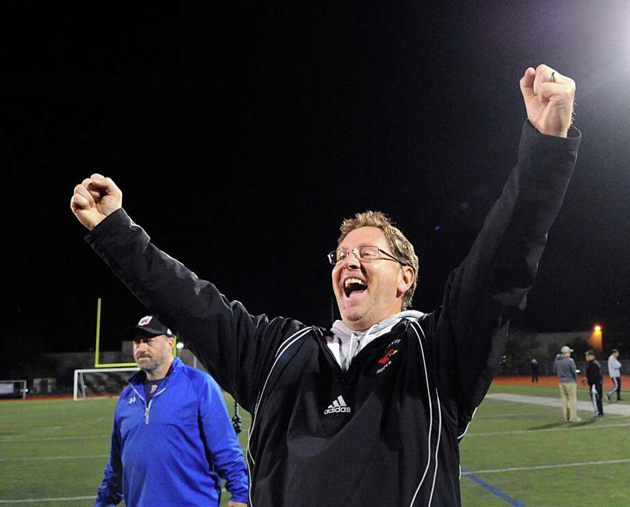 Greenwich High School soccer coach Kurt Putnam reacts at the victorious end of the FCIAC boys soccer championship game that his team won 1-0 over Trumbull High School at Norwalk High School, Conn., Thursday night, Nov. 2, 2017. Photo: Bob Luckey Jr. / Hearst Connecticut Media / Greenwich Time