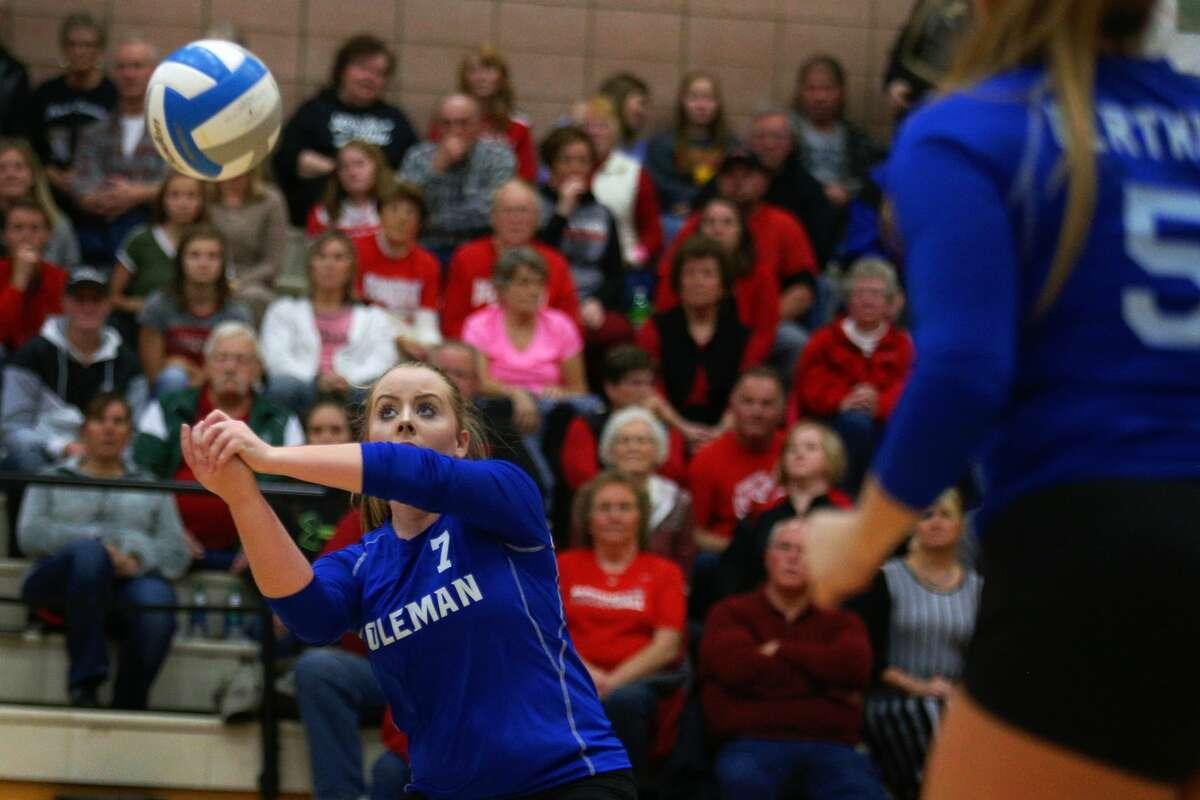 Coleman's Kalie Weidman bumps the ball during a game against Beaverton at Beaverton High School on Nov. 2, 2017. (Samantha Madar/for the Daily News)