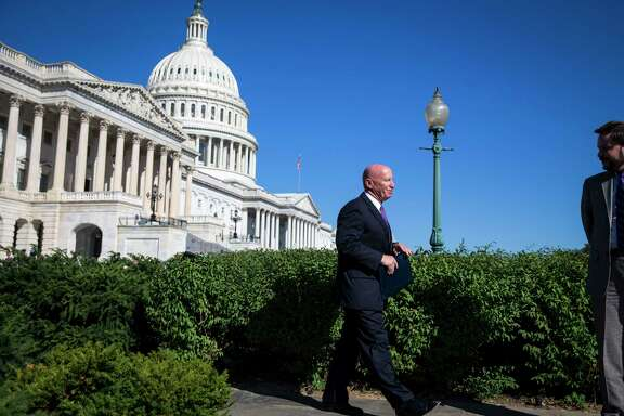 FILE -- Rep. Kevin Brady (R-Texas), chairman of the House Ways and Means committee, heads to a news conference on tax policy, on Capitol Hill in Washington, Sept. 28, 2017. One day before Republicans were to unveil a long-awaited tax plan on Nov. 1, many key details remain in flux, and lawmakers are still struggling with how to make the math work. (Al Drago/The New York Times)