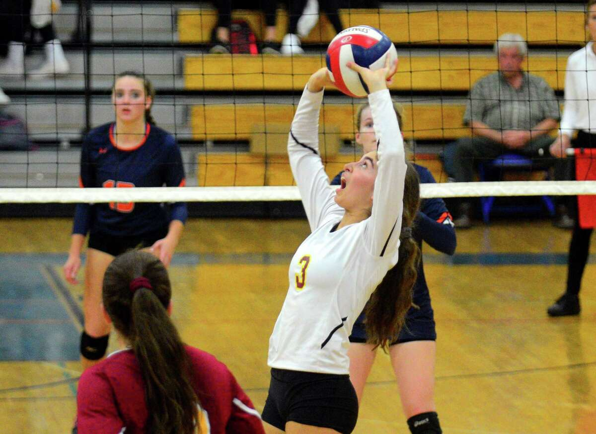St. Joseph's Grace Vocalina (3) sets the ball during FCIAC girls volleyball semifinal action against Danbury in Fairfield, Conn., on Thursday Nov. 2, 2017.