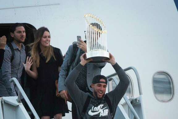 World Series MVP George Springer is happy to be carrying some extra baggage after the Astros arrived back in Houston on Thursday after winning Game 7 in Los Angeles on Wednesday.