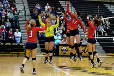 Hardin-Jefferson players cheer after scoring a point against Bridge City in the area round of the 4A volleyball playoffs at Vidor High School on Thursday evening. Photo taken Thursday 11/2/17 Ryan Pelham/The Enterprise