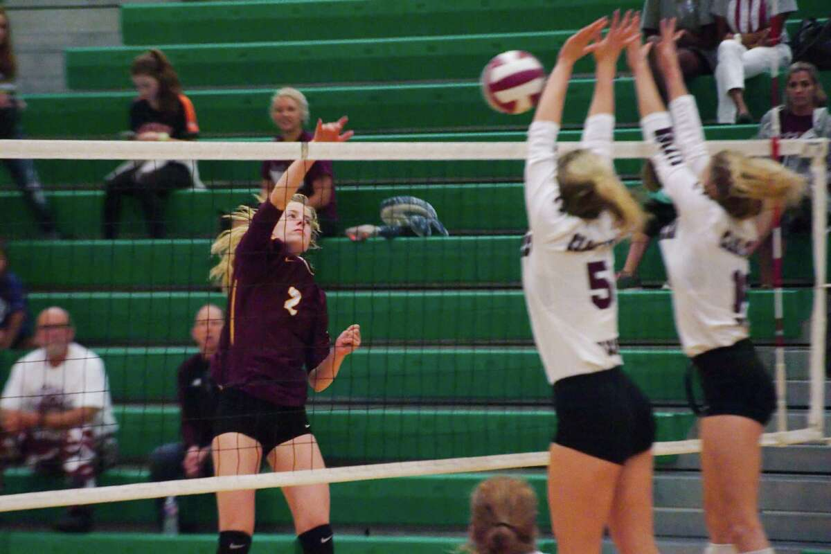 Deer Park's Phoebe Stigen (2) tries to hit a shot past Clear Creek's Riley Brantley (5) and Clear Creek's Kelsey Childers (16) Thursday, Nov. 2 at Clear Falls High School.