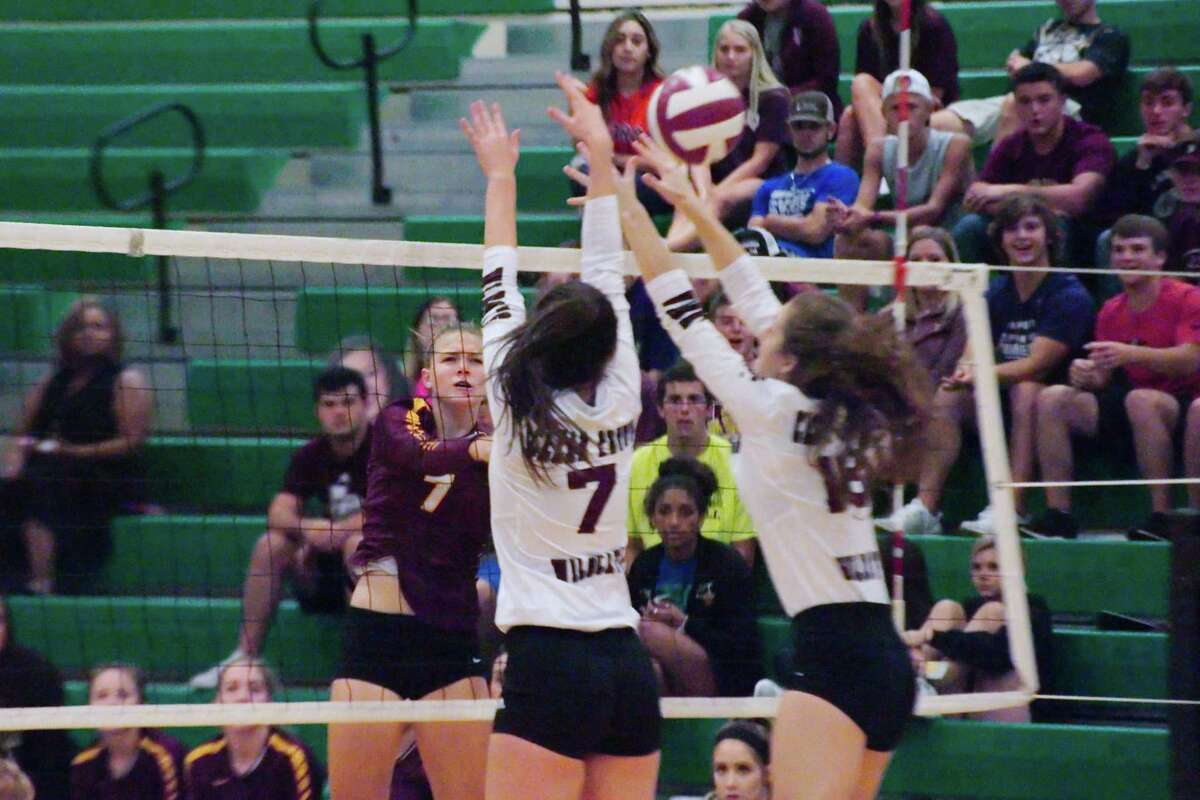 Deer Park's Hannah Baker (7) tries to hit a shot past Clear Creek's Sam Simmons (7) and Clear Creek's Alyssa Irvine (18) Thursday, Nov. 2 at Clear Falls High School.