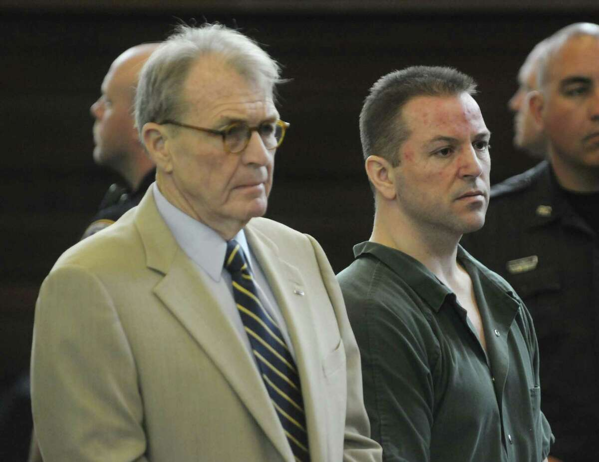 Defense attorney Terence Kindlon, left, and his client Michael Mosley stand as Mosley is sentenced in Judge Robert Jacon's courtroom at the Rensselaer County Courthouse on Tuesday morning, July 12, 2011 in Troy. Michael Mosley was sentenced to life for the murders of Samuel Holley and Arica Lynn Schneider. (Paul Buckowski / Times Union)