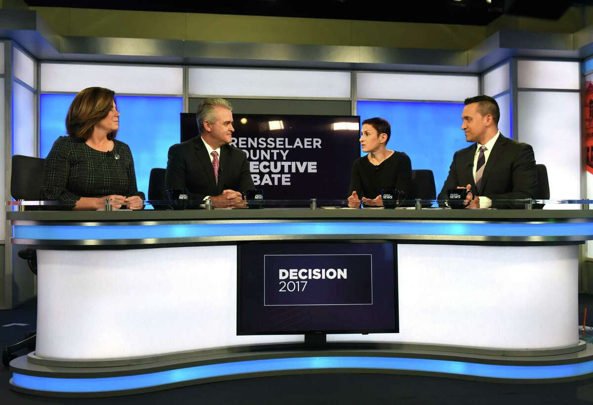 Candidates for Rensselaer County Executive; Democrat Andrea Smyth, left, and Republican Assemblyman Steven McLaughlin, second from left, take part in a debate at Spectrum News hosted by Liz Benjamin, second from right, and Solomon Syed, right, on Thursday, Nov. 2, 2017, in Albany, N.Y. (Will Waldron/Times Union)