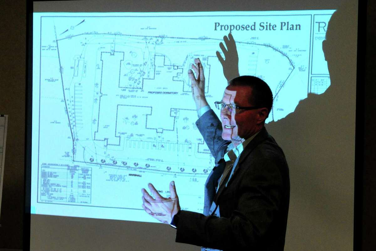 Architect Patrick Rose, with the firm Rose-Tiso & Co. in Fairfield, talks about proposed dormitories for Chinese students to be built at the former Marshall Lane Manor, during a public meeting at the facility along Marshall Lane in Derby, Conn. on Thursday Nov. 2, 2017.