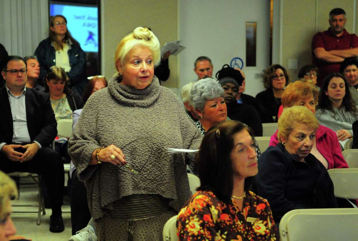 Derby resident Francine Gallo-Mure asks a question about proposed dormitories for Chinese students to be built at the former Marshall Lane Manor, during a public meeting at the facility along Marshall Lane in Derby, Conn. on Thursday Nov. 2, 2017.