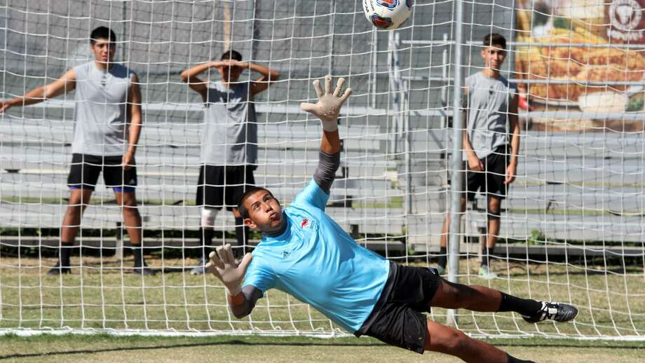 TAMIU junior goalkeeper Carlos Herrera was one of four players honored by the Heartland Conference Thursday ahead of the Dustdevils' semifinal showdown at undefeated No. 3 Midwestern State Friday at 7 p.m. He is third in the nation with a .867 save percentage and seventh with a .539 goals against average. Photo: Courtesy Of TAMIU Athletics, File