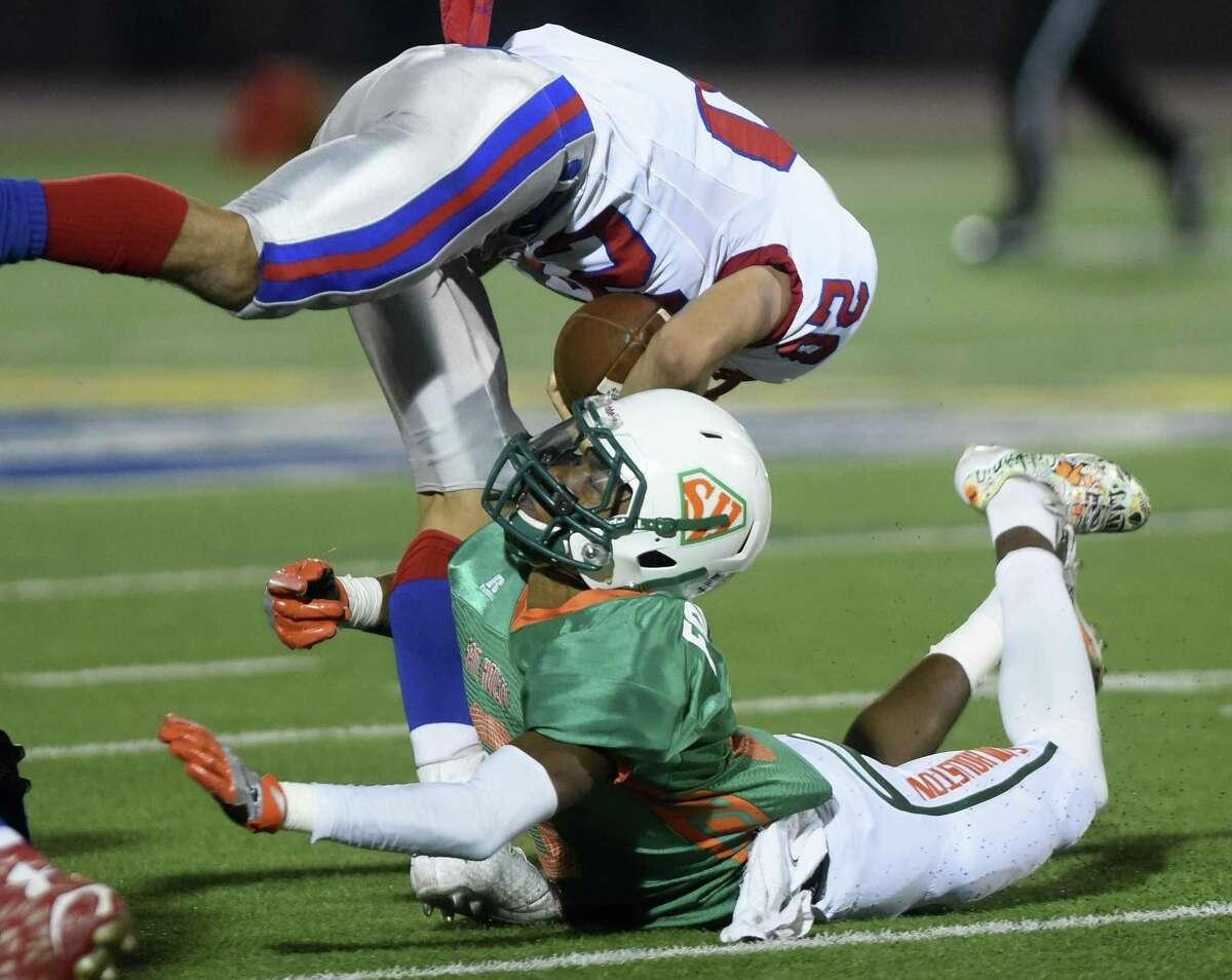 Sam Houston defensive back Lamar Miller, bottom, tackles Jefferson's Micah Garcia during football action at Alamo Stadium on Thursday, Nov. 2, 2017.