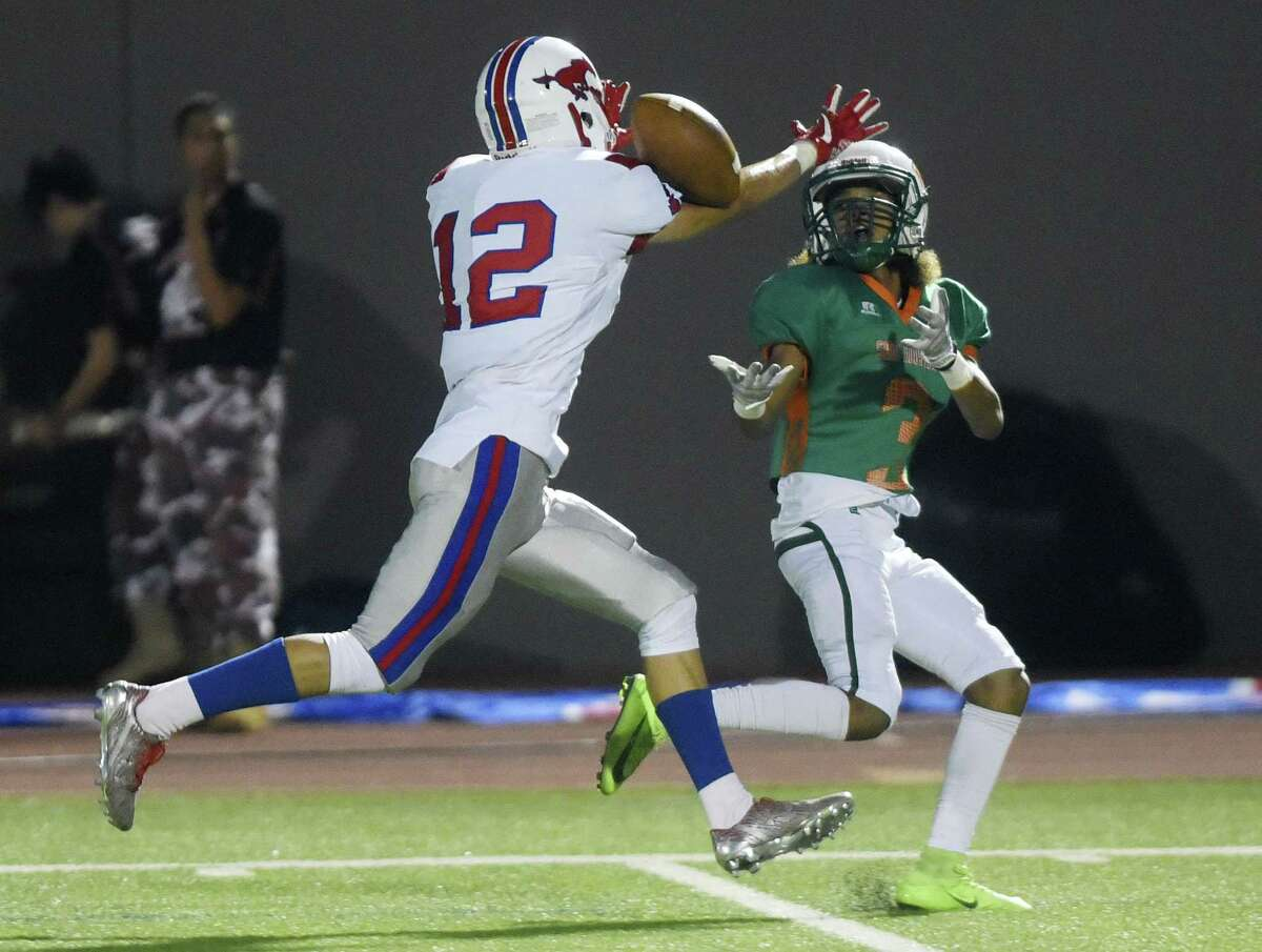 Jefferson defender Nathan Velasquez (12) breaks up a pass intended for D'Shawn Bell of Sam Houston during football action at Alamo Stadium on Thursday, Nov. 2, 2017.