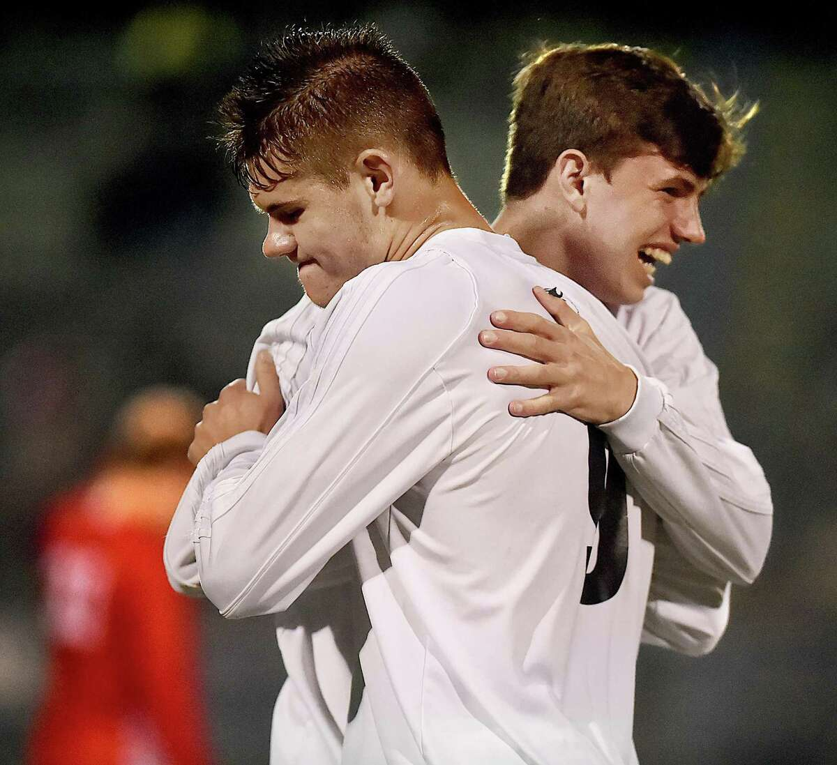 Hand juniors Lee Wildermann and Greyson McGeary celebrate following their 4-2 win over Fairfeld Prep in the SCC championship, Thursday, Nov. 2, 2017, at Ken Strong Stadium at West Haven High School.