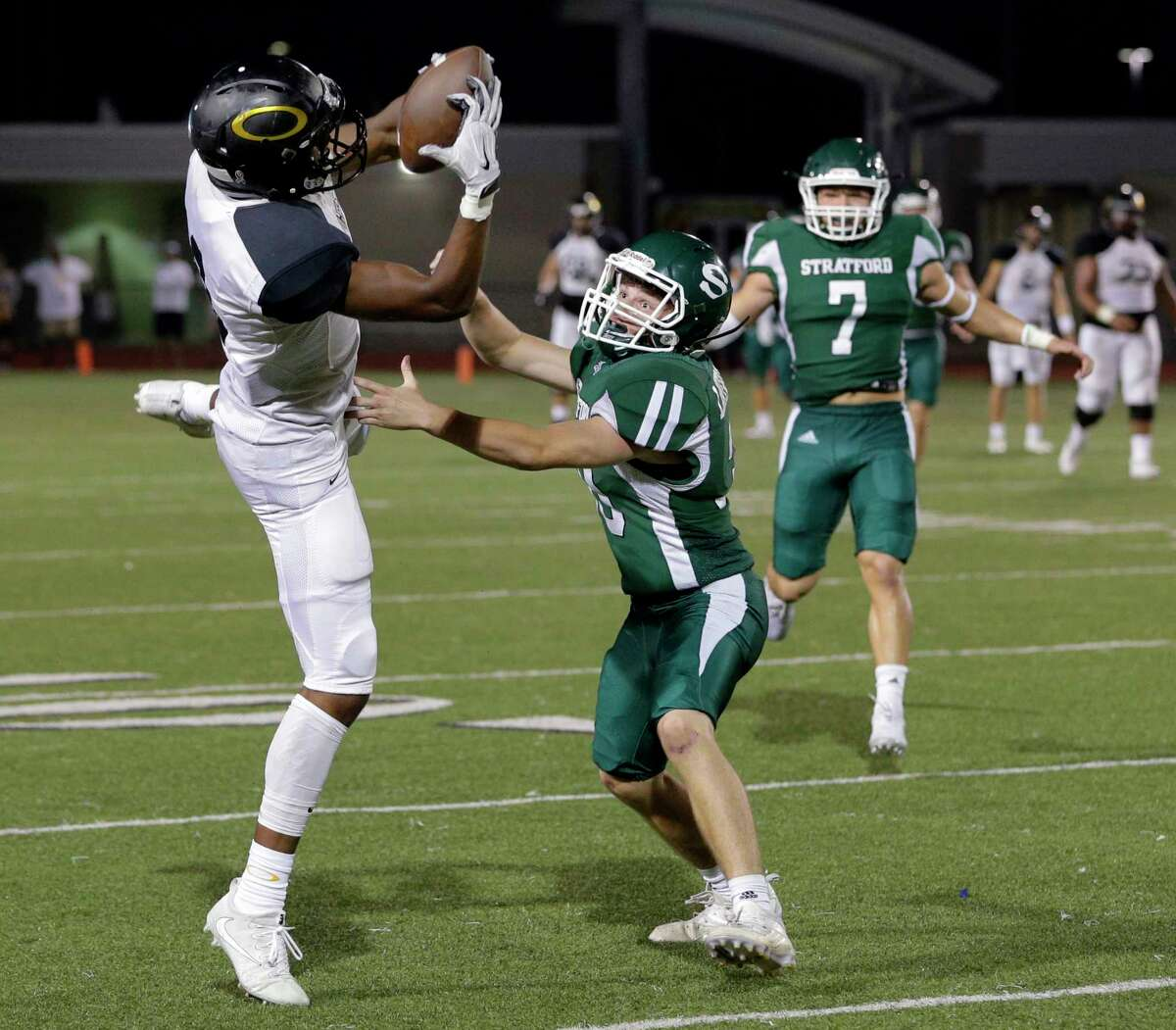 Klein Oak's Tyler Hudson (3) pulls in a reception over Stratford's Walker Lavercombe (30) as Jonathan Ziobrowski (7) closes in during the second half of their game, Nov. 2, 2017, in Spring, TX. (Michael Wyke / For the Chronicle)