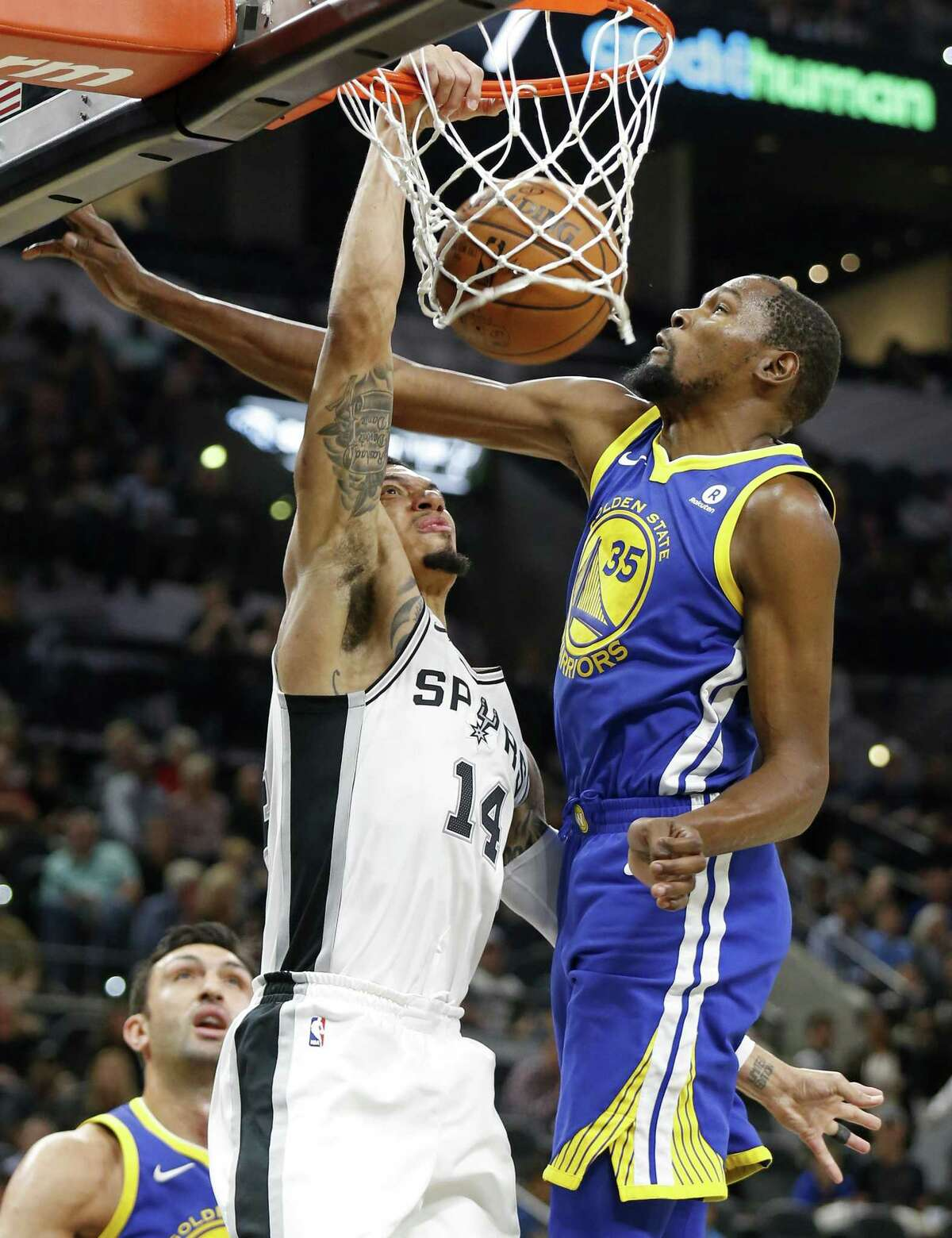 San Antonio Spurs?• Danny Green dunks around Golden State Warriors' Kevin Durant during first half action Thursday Nov. 2, 2017 at the AT&T Center.