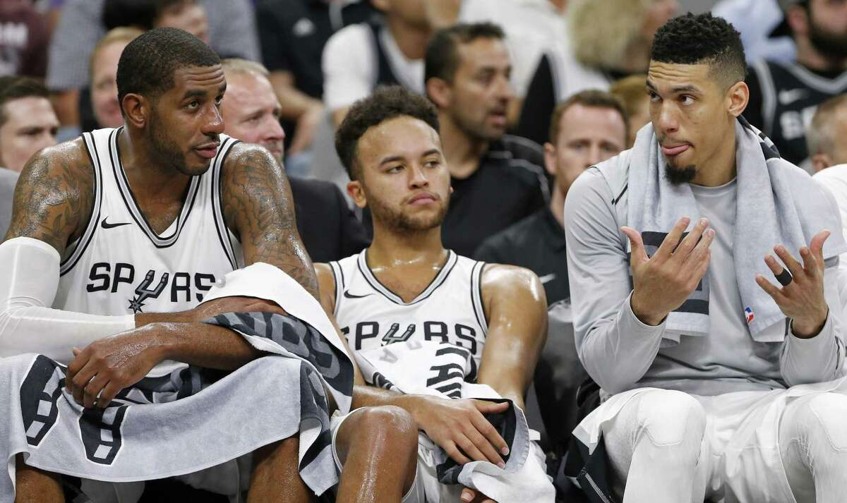 San Antonio Spurs?• LaMarcus Aldridge (from left) Kyle Anderson, and Danny Green sit on the bench late in second half action against the Golden State Warriors Thursday Nov. 2, 2017 at the AT&T Center. The Warriors won 112-92.