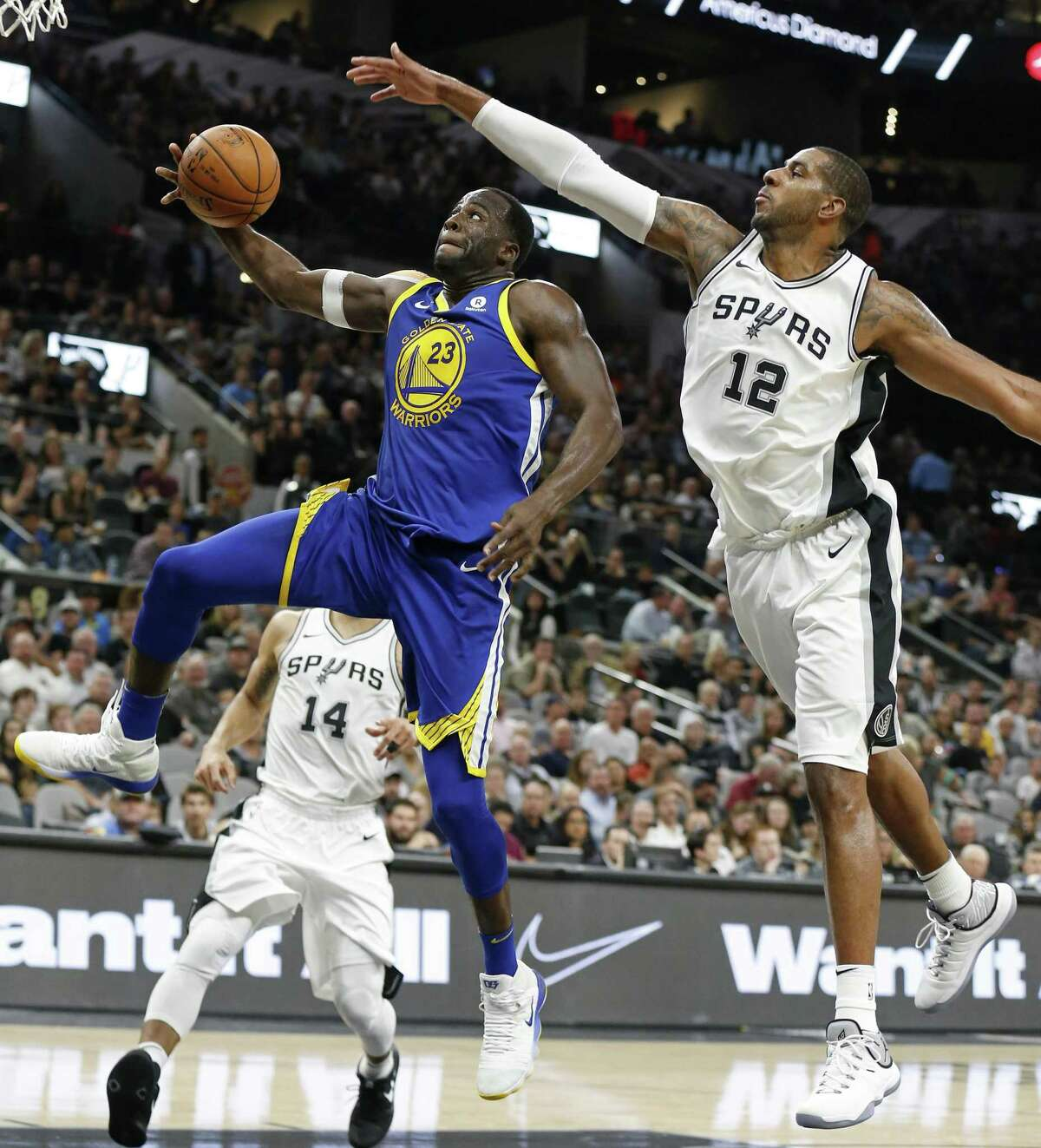 Golden State Warriors' Draymond Green goes up for a dunk around San Antonio Spurs?• LaMarcus Aldridge during second half action Thursday Nov. 2, 2017 at the AT&T Center. The Warriors won 112-92.