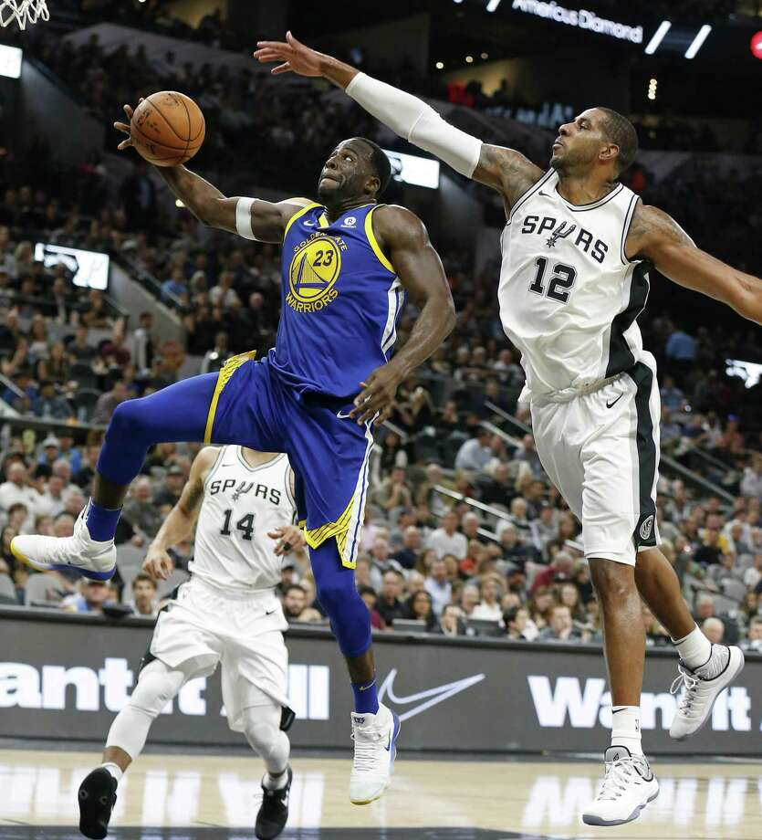 Golden State Warriors' Draymond Green goes up for a dunk around San Antonio SpursÕ LaMarcus Aldridge during second half action Thursday Nov. 2, 2017 at the AT&T Center. The Warriors won 112-92. Photo: Edward A. Ornelas, Staff / San Antonio Express-News / © 2017 San Antonio Express-News