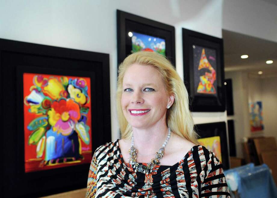 Tiffany Benincasa owner of the C. Parker Gallery inside her business at 409 Greenwich Avenue, Greenwich, Conn., Thursday, Nov. 2, 2017. Photo: Bob Luckey Jr. / Hearst Connecticut Media / Greenwich Time