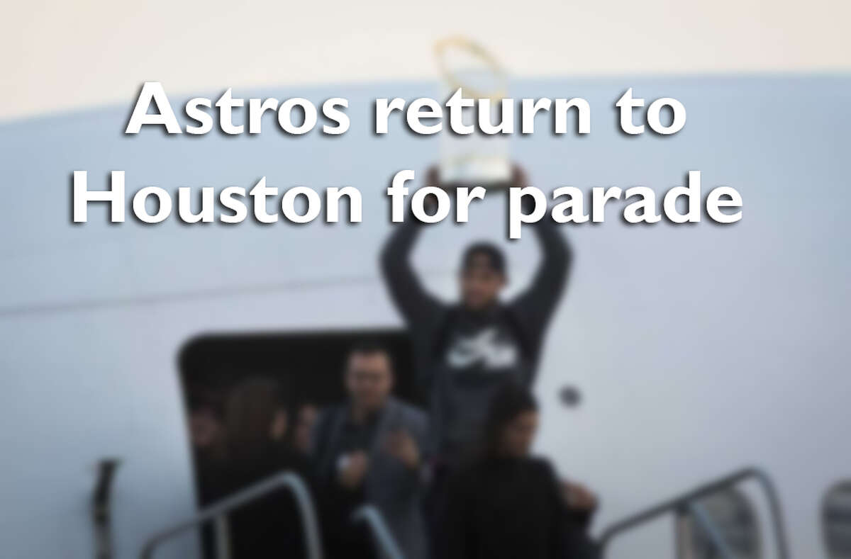 Swipe through to see photos of the Astros return to Houston for the parade Friday.