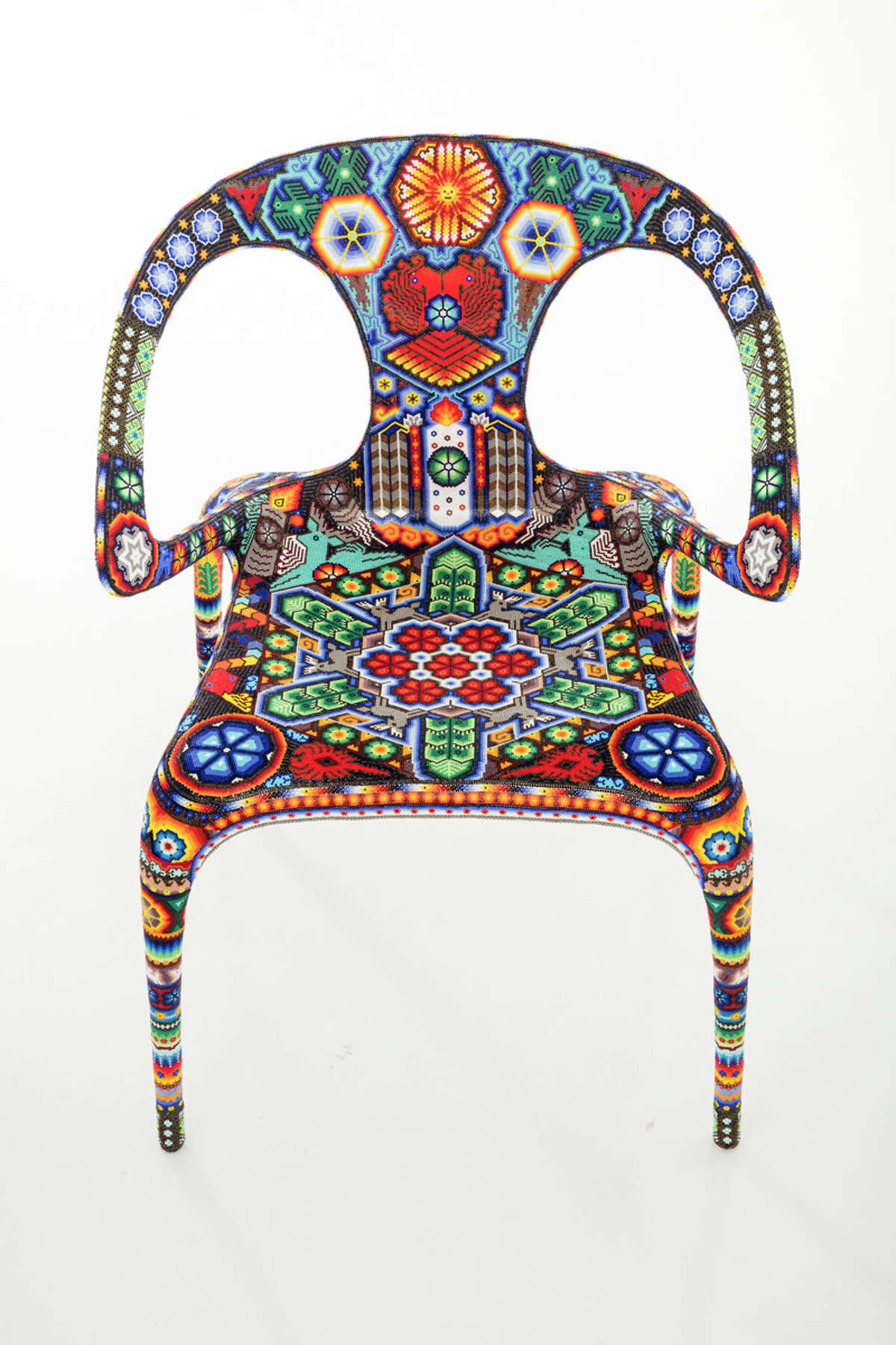 Traditional Mexican craftsmen reinvented Roche Bobois' iconic Ava chair in their own style.
