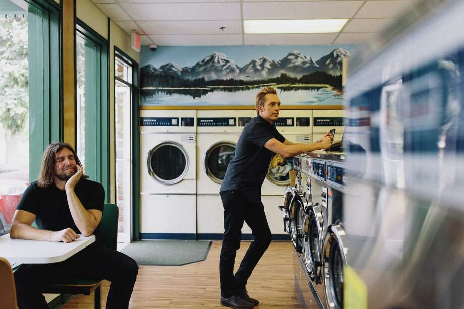 The Minimalists are best-selling authors and hosts of a popular podcast.Joshua Fields Millburn, right, and Ryan Nicodemus advise people on ways to eliminate the excess stuff in their lives. Photo: Joshua Weaver