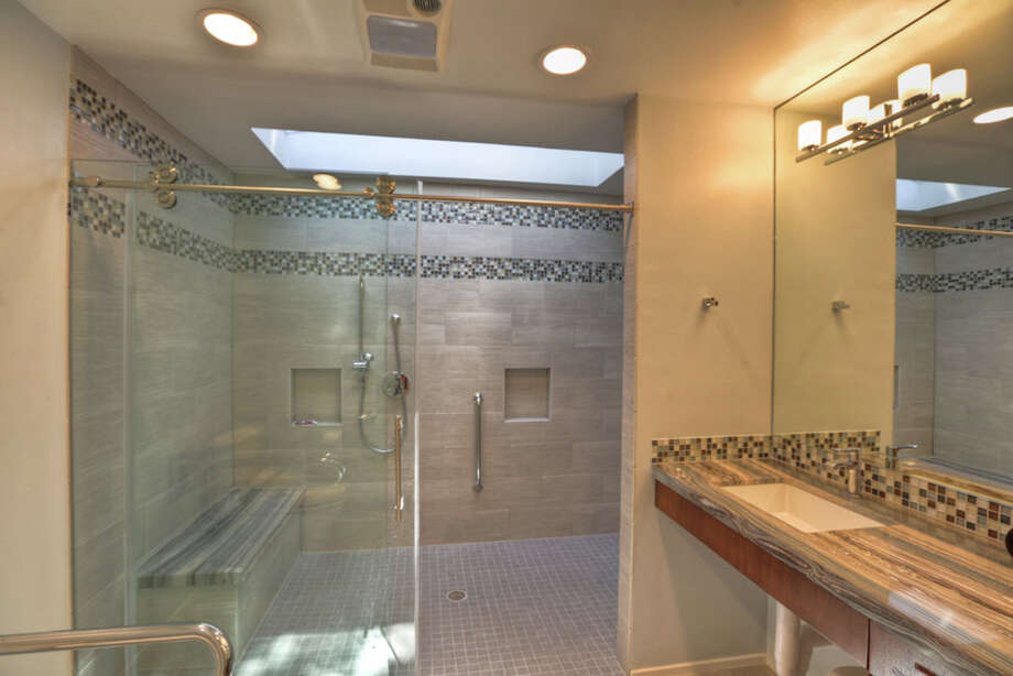 Shown is a frameless glass shower enclosure with clear glass. Photo: Courtesy Of A-Plus Glass Service