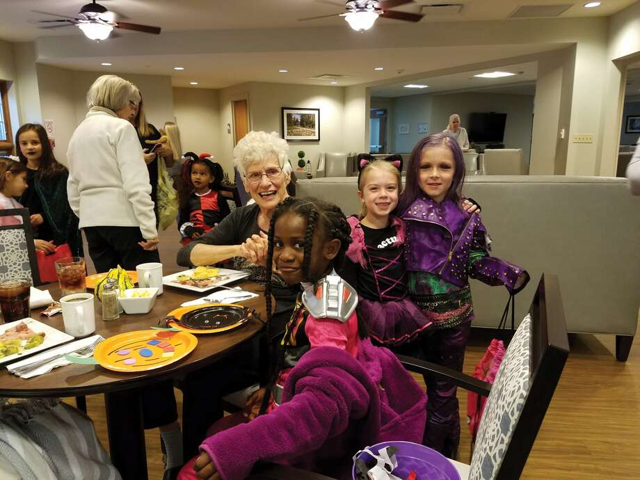 "Residents at Cedarhurst and Ruth's House Memory Care Homes enjoyed the ""sweetness"" of Trick-or-Treaters on Monday, October 30th.  Residents were joined by the Girl Scouts of Hamel for an exciting evening of tasty treat giving, in Edwardsville. Photo: For The Intelligencer"