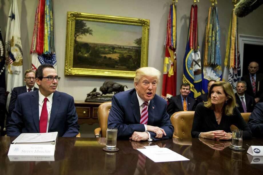 President Donald Trump (center) speaks while Treasury Secretary Steve Mnuchin (left), and Karen Kerrigan, president and chief executive officer of the Small Business & Entrepreneurship Council, listen during a tax reform industry meeting at the White House in Washington on Tuesday, Oct. 31, 2017. Photo: Bloomberg Photo By Al Drago. / © 2017 Bloomberg Finance LP