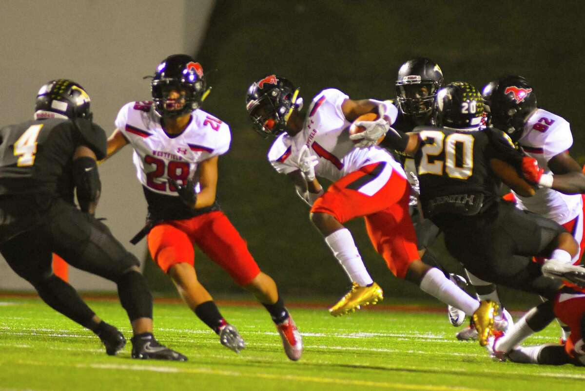 Westfield running back Rayshawn James scrambled for yards during the Mustangs' 31-3 victory against Eisenhower in Week 10, securing at least a share of their second straight district championship.