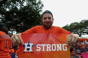 Houston Astros fan Charles Rice, 32, currently lives in Los Angeles but is originally from Houston, poses for a photograph as people set up for the World Series Championship parade Friday, Nov. 3, 2017, in Houston.