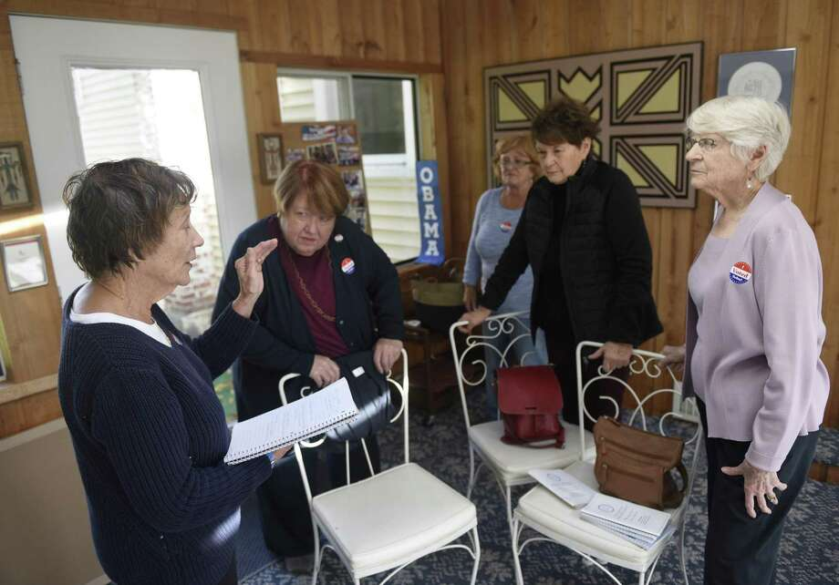 Joan Krantz, left, leads a meeting with Women on Watch (WOW) members during a meeting at member at her home in Stamford, Conn. Monday, Oct. 30, 2017. Women on Watch is a grassroots political initiative promoting awareness, advocacy and action relating to key local and national issues. Photo: Tyler Sizemore / Hearst Connecticut Media / Greenwich Time