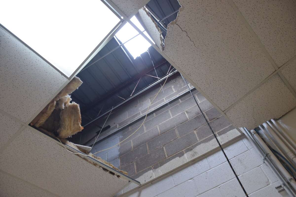 Burglars cut a hole in the roof of a Northeast Side Verizon Wireless distributor, rappelled down into the store and robbed $50,000 worth of property on Friday morning.