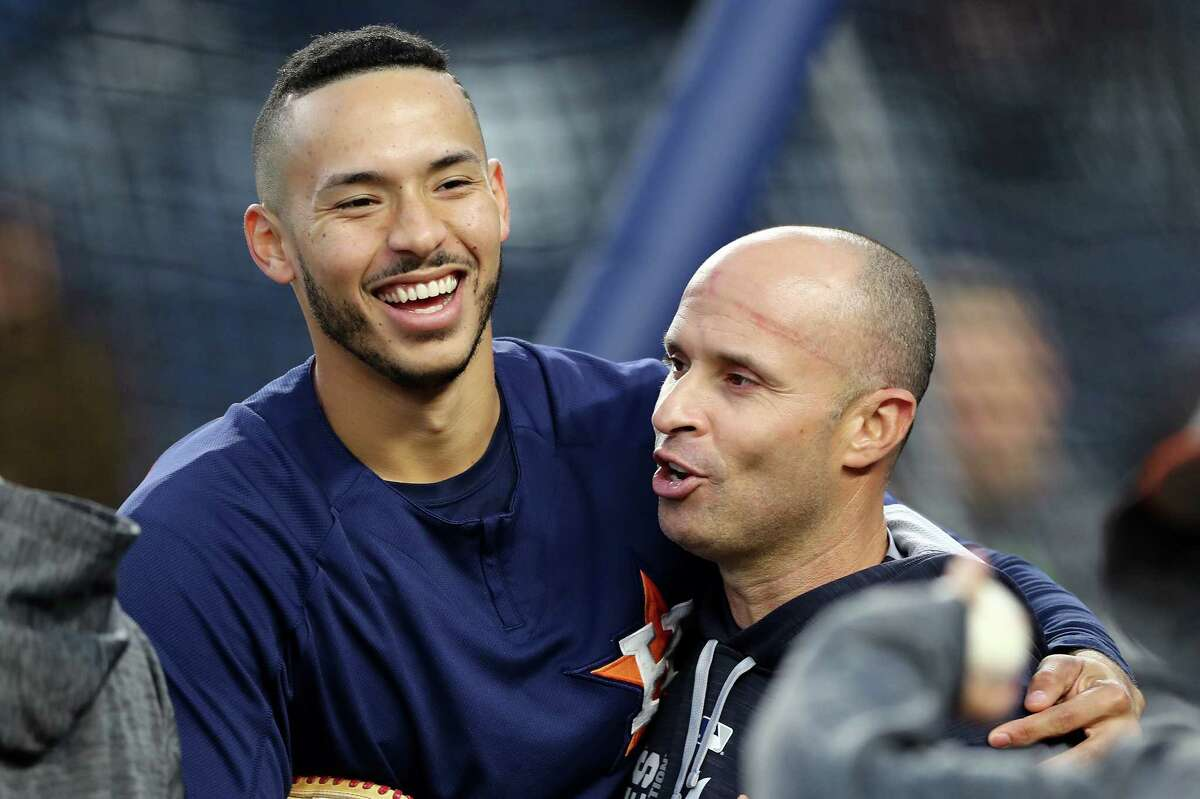 NEW YORK, NY - OCTOBER 16: Carlos Correa #1 of the Houston Astros hugs Joe Espada #53 of the New York Yankees before Game Three of the American League Championship Series at Yankee Stadium on October 16, 2017 in the Bronx borough of New York City.