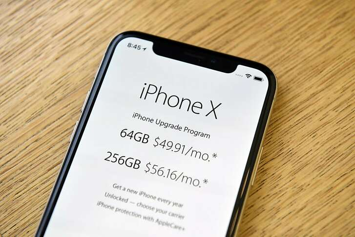 An Apple Inc. iPhone X smartphone is displayed during the sales launch at a store in San Francisco, California, U.S., on Friday, Nov. 3, 2017. The $1,000 price tag on Apple Inc.'s new iPhone X didn't deter throngs of enthusiasts around the world who waited -- sometimes overnight -- in long lines with no guarantee they would walk out of the store with one of the coveted devices. Photographer: Michael Short/Bloomberg