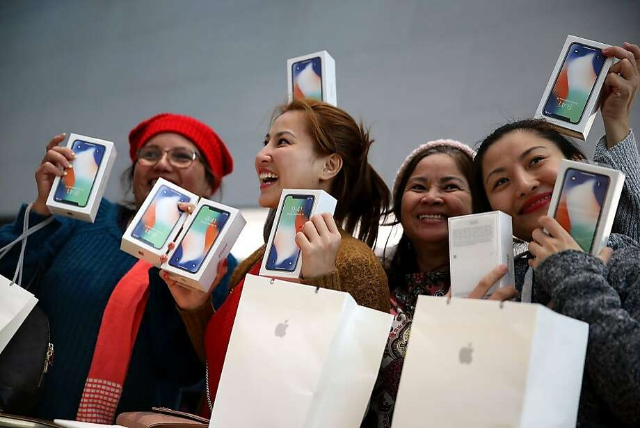 Customers hold up the new iPhone X at an Apple Store on November 3, 2017 in Palo Alto, California. The highly anticipated iPhone X went on sale around the world today.  Photo: Justin Sullivan, Getty Images