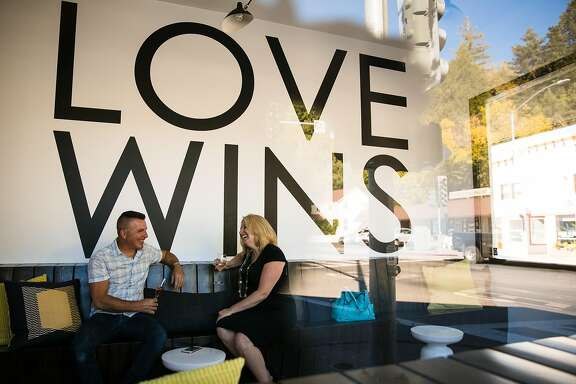 Kurt Giusti and Jennifer Neeley share laugh at Equality Wines tasting room in Guerneville, Calif. Wednesday, October 25, 2017.