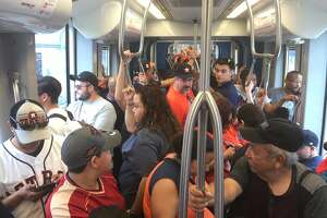 A Metro train was full before it arrived at Near Northside on the way to downtown Houston on the morning of Nov. 3, 2017, prior to the Astros' victory parade.