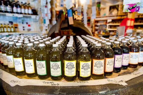 Bottles of olive oil line a display at Napa Valley Olive Oil Manufacturing Company in St. Helena, Calif., on Saturday, Oct. 7, 2017.