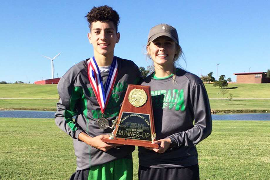 Floydada freshman Kaleb Crone, left, and cross country coach Chelsea Wheeler display the trophy Crone won for his effort at the district meet. Crone will run in the UIL Class 2A State Cross Country Meet Saturday afternoon at Old Settlers Park in Round Rock. Photo: Courtesy Photo